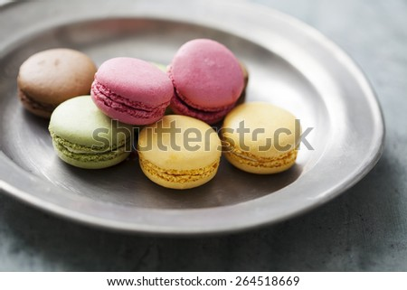 vintage dish with colourful macaroons - stock photo