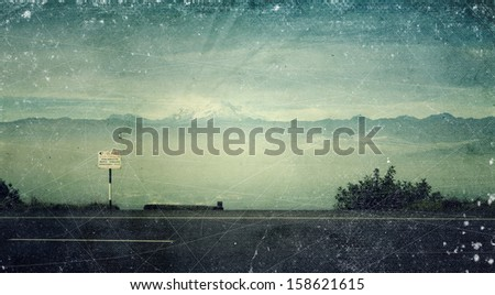 Vintage distressed photo: a road in the mountains - stock photo