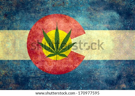 Vintage distressed retro version of the Colorado State flag with Marijuana leaf in center. - stock photo
