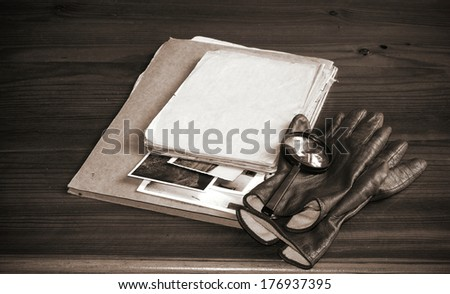 Vintage documents with magnifying glass investigation concept - stock photo