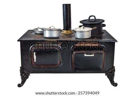 Vintage doll house cooking stove with pans isolated on a white background - stock photo