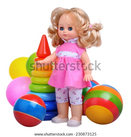 Vintage doll with toys isolated on white background - stock photo