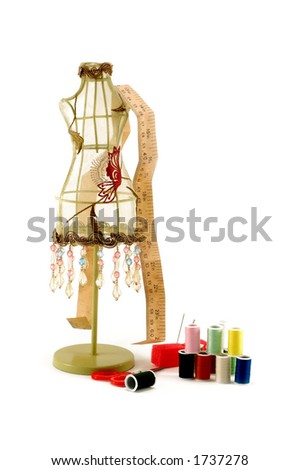 Vintage dress model and sewing equipment - stock photo
