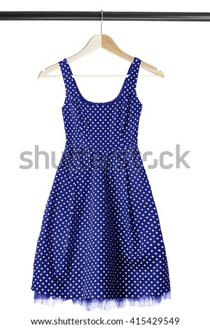 Vintage dress on wooden clothes rack isolated over white - stock photo