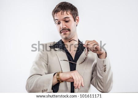 Vintage drug user looking at gold watch with sunglasses mustache ready for a good time