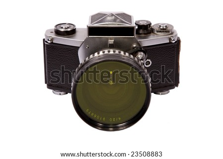 Vintage east german film slr camera with green filter on ultra wide lens - stock photo