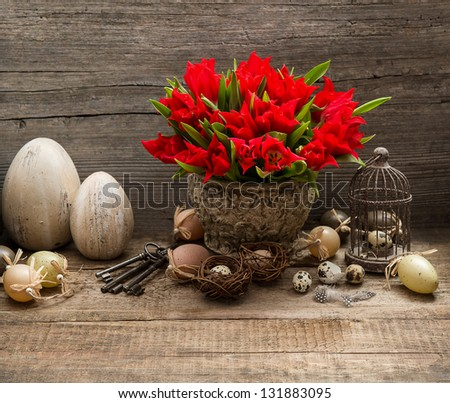 vintage easter decoration with eggs and red tulip flowers. nostalgic still life home interior - stock photo