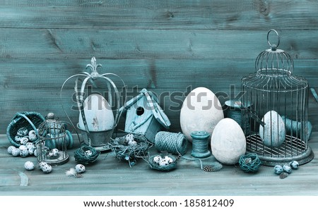 vintage easter decoration with eggs, nest and birdcage. nostalgic still life. retro style toned picture - stock photo