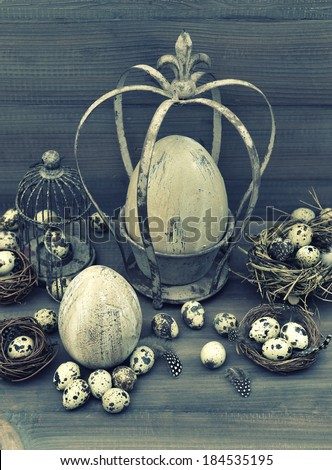 vintage easter decoration with eggs, nest and birdcage. retro style toned picture - stock photo