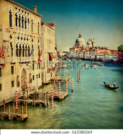 Vintage edited image from the Grand Canal of Venice with the famous landmark cathedral Santa Maria della Salute at the background  - stock photo