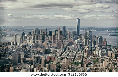 Vintage effect of New York City, Cityscape view of Manhattan with skyscrapers and blue sky by day. - stock photo