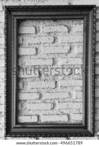 Vintage Empty Frame hang on Brick  Wall black and white theme