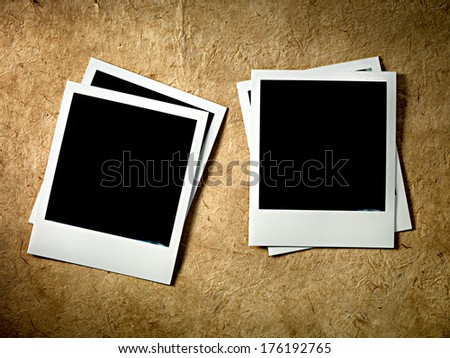Vintage empty photo cards on paper background
