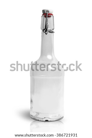 Vintage empty transparent bottle isolated on the white background. Clipping Path - stock photo