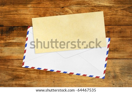 Vintage Envelope with blank Brown  paper on wood .