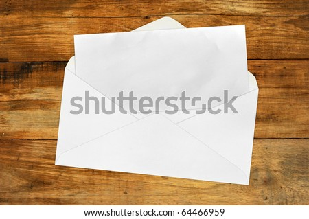Vintage Envelope with blank paper on wood . - stock photo