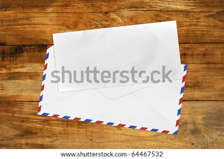 Vintage Envelope with blank paper on wood .
