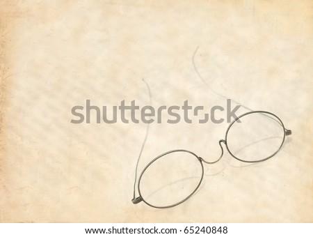 vintage eye glasses parchment - stock photo