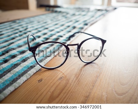 Vintage eyeglasses in window light.