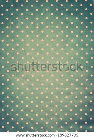Vintage Fabric Texture Pattern with Pink Polka Dots on Grey background, retro style with vignette - stock photo