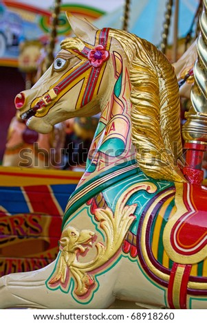 Vintage fairground merry-go-round ride - stock photo