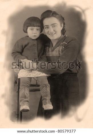 Vintage family portrait.The shot was taken around 1954 year. - stock photo