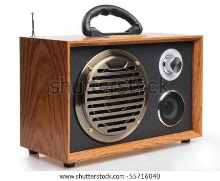 Vintage fashioned radio on white background - stock photo