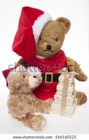vintage Father Christmas teddy bear giving presents to his friend isolated on white background
