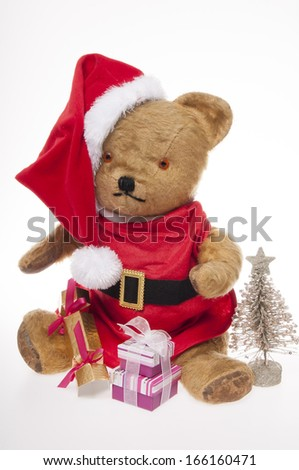 vintage Father Christmas teddy bear with presents  isolated on white background