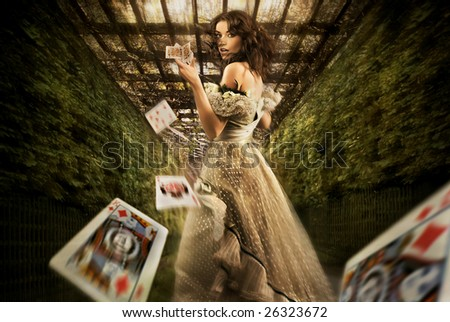 Vintage female magician throwing playing cards - stock photo