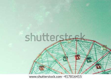 Vintage ferris wheel over blue sky - stock photo