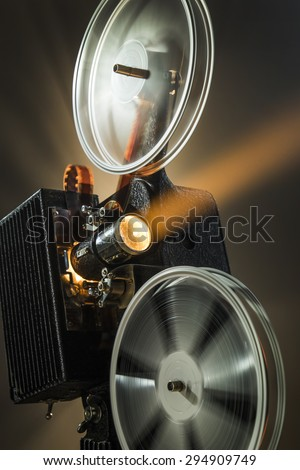 Vintage film projector in color - stock photo
