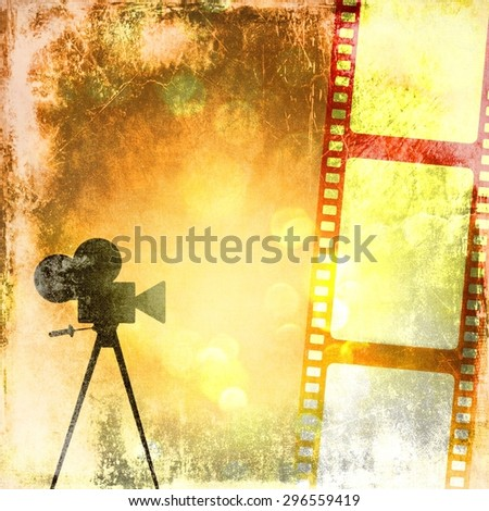 Vintage film strip background and old cinecamera - stock photo