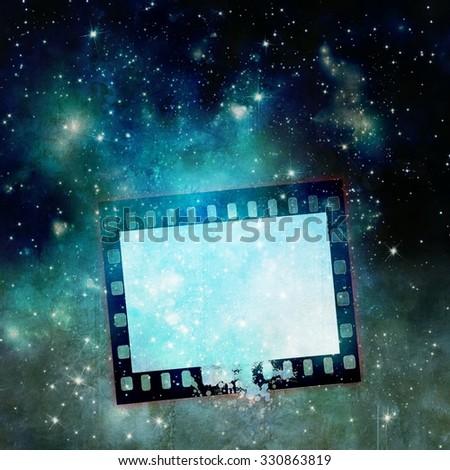 Vintage film strip frame on starry sky - stock photo