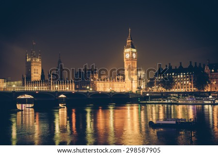 Vintage filter style London skyline at night with Big Ben and Thames  - stock photo