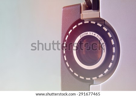 vintage filtered close up  image of old 8mm Film Projector lens - stock photo