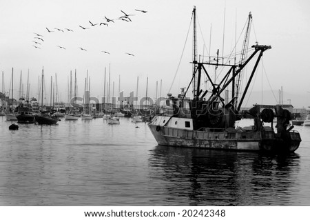 Vintage fishing boat in harbor - stock photo