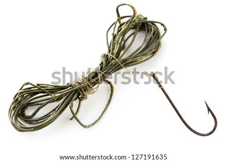 Vintage fishing line and rusted hook, isolated on white. - stock photo