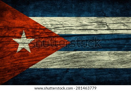 Vintage flag of Cuba on wooden surface - stock photo