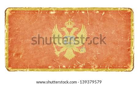 Vintage flag of Montenegro. - stock photo
