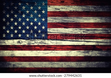 Vintage flag of the United States on wooden surface