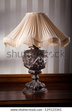Vintage floor lamp on a table - stock photo