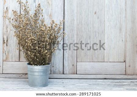 Vintage flower on wood table - stock photo