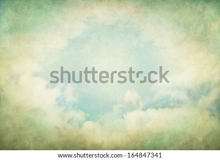 Vintage fog and clouds with glowing green and yellow colors.  Image displays a pleasing paper grain and texture at 100%.  - stock photo
