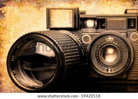 Vintage folding camera with a grunge texture of scratches added for effect - stock photo