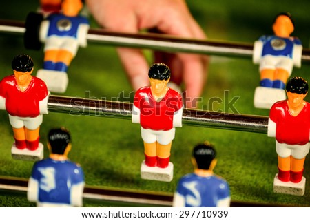 Vintage Foosball, Blue and Red Players Team in Table Soccer or Football Kicker Game, Selective Focus, Retro Tone Effect - stock photo