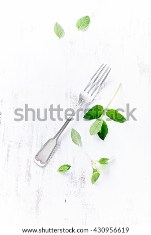 Vintage Fork with Fresh Herbs - stock photo