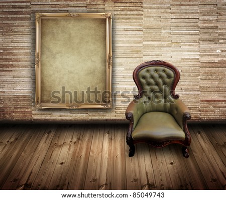 vintage frame and retro leather chair in brick wall room - stock photo