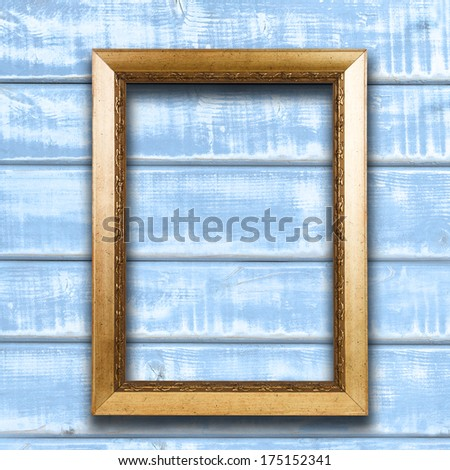 Vintage frame on wooden wall background with copy space - stock photo