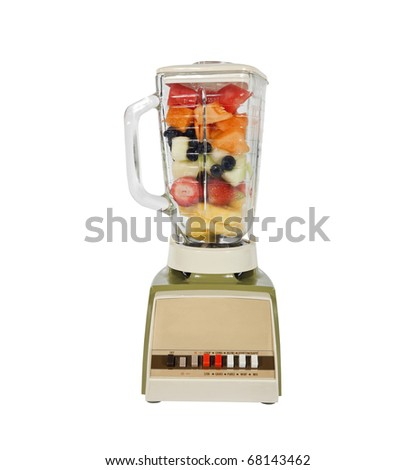 Vintage fruit and mellon filled blender ready to rip. - stock photo